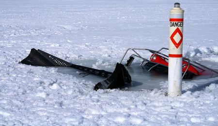 Snowmobile trail groomer breaks through ice in Idaho lake photo
