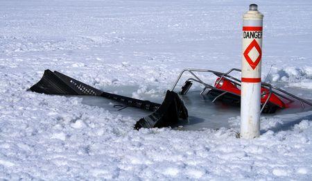 groomer: Snowmobile trail groomer breaks through ice in Idaho lake