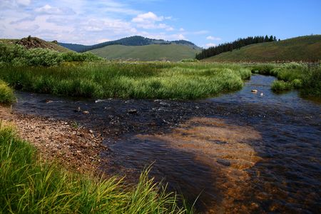 Stanley Creek as it flows through high mountain meadow, Stanley Idaho