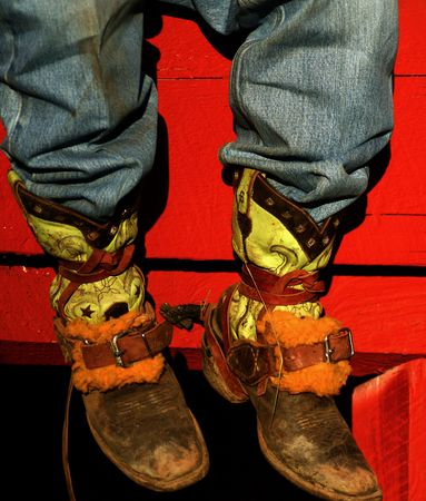 Well worn boots adorn the wranglers at rodeo in small county fair, Idaho Stock Photo - 3416135
