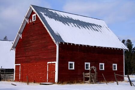 Red barn in early winter in central Idaho Stock Photo