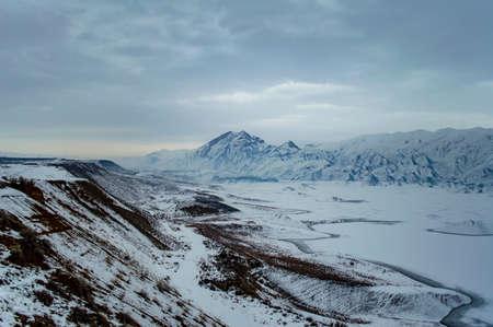 Beautiful winter landscape in Armenia with Azat reservoir and Yeranos mountain range