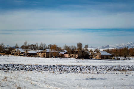 Scenic snowy view of a remote village in the north of Armenia, Shirak province, on a winter day Imagens