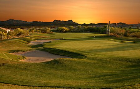 The eighteenth hole at sunset.