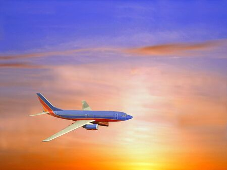 Airliner in a brilliant sunset sky of reds, yellows and traces of blue.