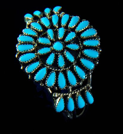 silver jewelry: A unique Navajo Indian bracelet of turquoise and silver with the stones set in a circle. Stock Photo