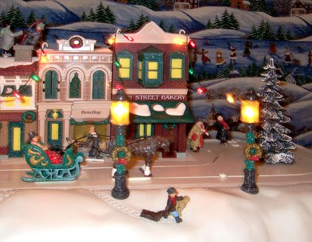 horse sleigh: Miniature Christmas scene with horse drawn sleigh and figurines.