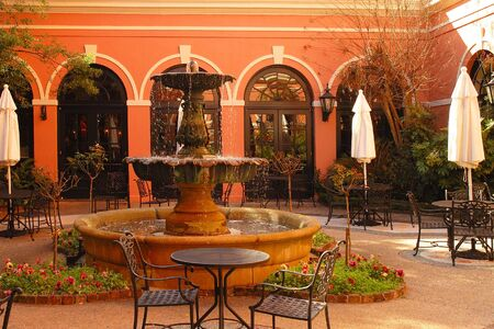 Courtyard with beautiful fountain, plants and arches with spanish atmosphere. Stock Photo - 2330631