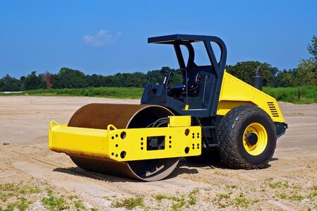 leveling: Heavy duty drum roller for grading construction site.