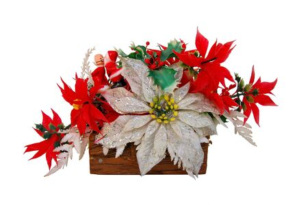Colorful red and white poinsetta and holly arrangement with Mr. and Mrs. Santa figurines Clause - over white.