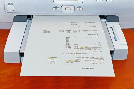 Printer generating a stock analysis report.