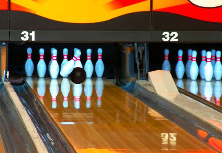 Bowling ball making contact with head pin in the strike zone. photo