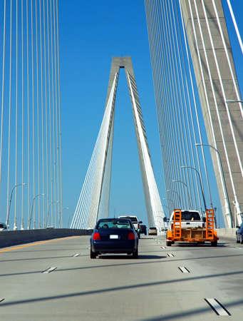 cooper: Crossing the Arthur J. Ravenel bridge with traffic on the Cooper  River in Charleston, South Carolina.