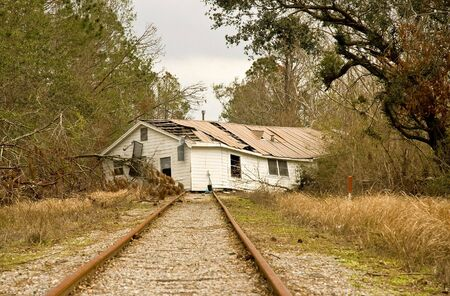 transplanted: House on Railroad Treacks Stock Photo