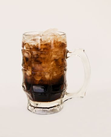 root beer: Ice cold, frosty mug of root beer to quench your thirst on a hot daymakes for a refreshing softdrink. Stock Photo