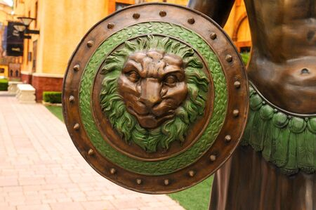 A wariors shield with the Roman insignia - the lion s head.