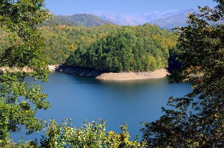 Elevated view of colorful Fontana Lake and Smokey Mountain Range. photo