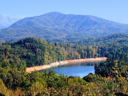 Areial view of a mountain lake nestled in the magestic Smokey Mountains. photo