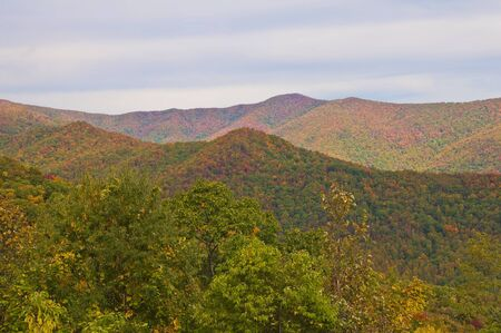 A view of the Smoky Mountain Range from the Cherohala Trail with a burst of Fall colors. photo