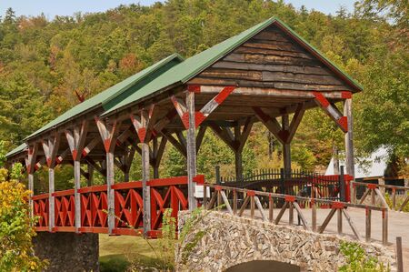 Covered Bridge with a backdrop of Fall Colors near Teleco Plains, North Carolina in the Smoky Mountains. photo