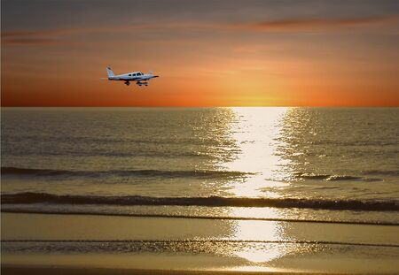 Private plane in flight at sunset near Clearwater Beach, Florida