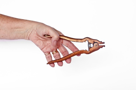 crimp: Man gripping chain pliers used for adjusting the length of chains by opening links for removal and crimping them