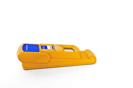 determine: Electronic stud finder used by electricians to locate metal or wood studs in a wall or ceiling,