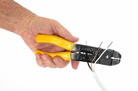 crimper: Man stripping wire with a handy combination wire stripper, terminal crimpe and cutter
