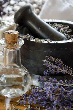crushing: grinding and crushing of dried lavender with a stone mortar
