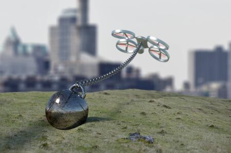 tethered: drone with a ball tethered on a long chain Stock Photo