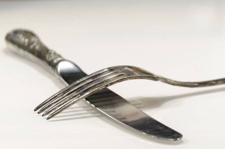 grunge flatware: old cutlery on marble table in different posiotions Stock Photo