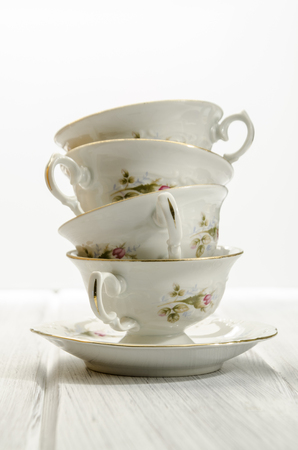 teacup: two stylish antique teacups on white background