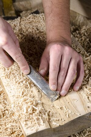 joinery: joinery tools - chisel on wooden table with sawdust