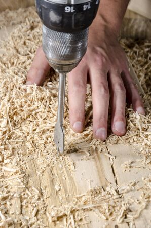 joinery: joinery tools - drilling in wood Stock Photo