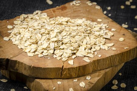 trencher: raw oatmeal scattered on the brown trencher