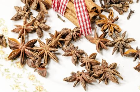 stick of cinnamon: anise and cinnamon on antique white plate