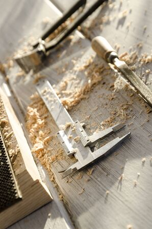 joiner: used joiner tool in different positions on wooden table