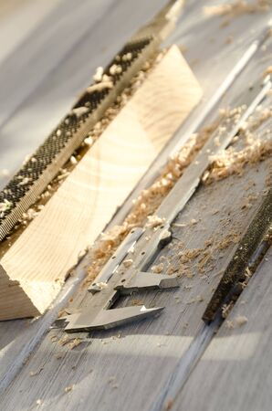 carpenter's sawdust: used joiner tool in different positions on wooden table