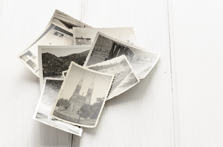 old time: Stack of old photographs with copy space