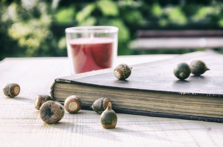 stack of old books on a wooden table in the garden Stock Photo