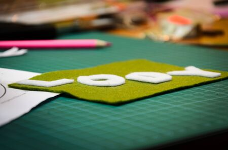 Manual cutting letters with colored sheets of felt Stock Photo