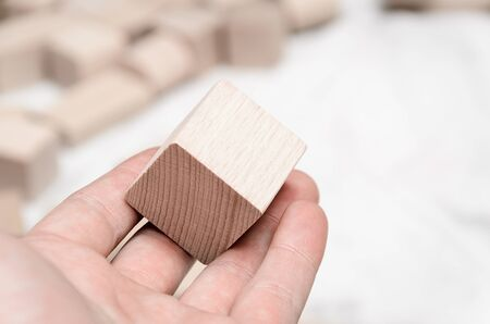 Educational blocks made of natural wood with soft light