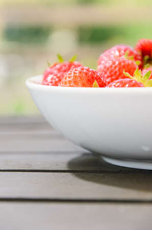 Red tasty strawberries on white plate