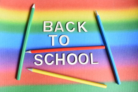 Lettering Back to School with four Crayons on the Rainbow Background