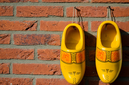 klompen: Dutch wooden shoes hanging on a wall