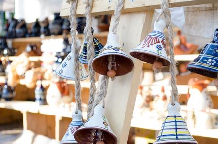 folk festival: Ceramic painted bells as souvenir