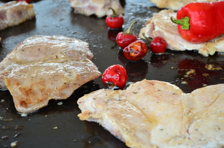 Grilled pork meat with red peppers photo