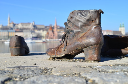 danuba: Shoes symbolizing the massacre of Jewish people shot at the river Danube in Budapest in the second world war. Stock Photo
