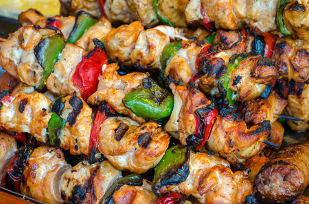 roast meat: Skewers on wooden stick with tasty pork meat and vegetables mix