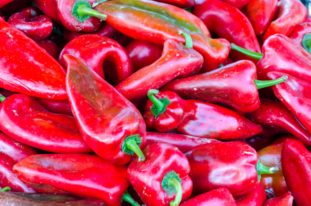 Sweet organic red paprika. Kapia red peppers on farmers market as background.